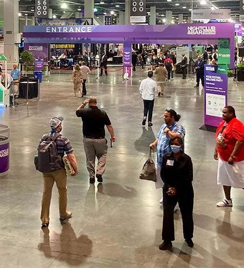 People standing in the large expo hall.